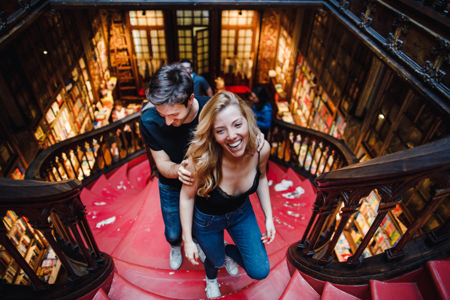 engagement session porto lello bookshop portugal destination couple wake up together pillow fight breakfast in bed