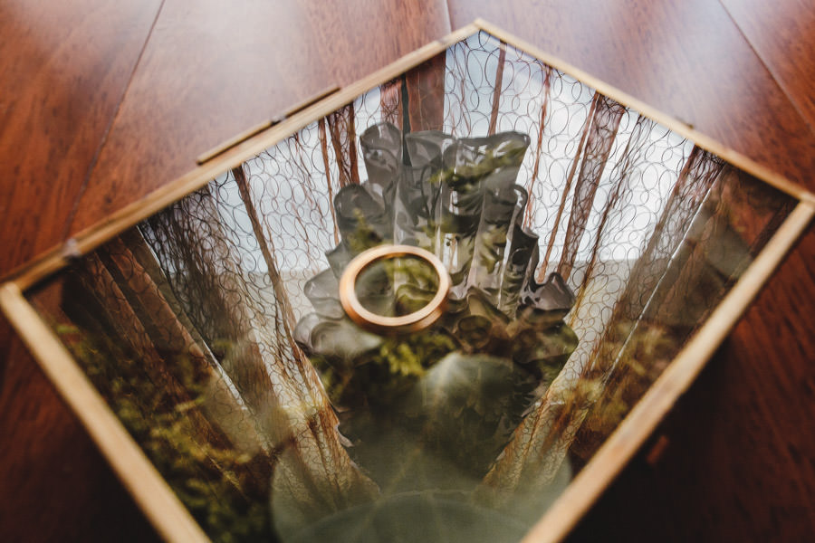 wedding photography rings and dress reflection