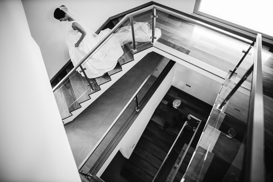 wedding photography bride and father in the stairs