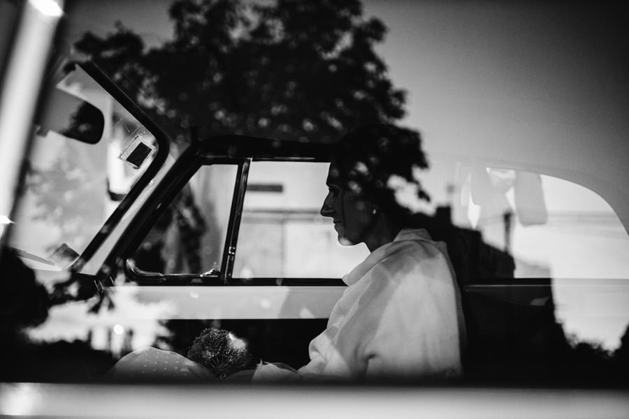 wedding photography bride in the car on reflection