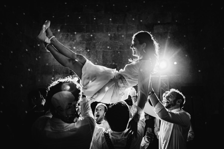 wedding photography Amares throwing bride in the air